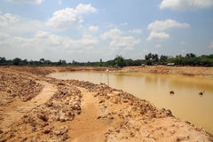 The irrigation water reservoir under construction. Stock Photo