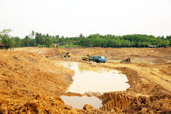 The irrigation water reservoir under construction. Stock Photography