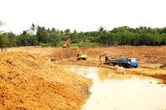 The irrigation water reservoir under construction. Stock Photos