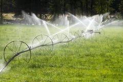 Irrigation Wheel Line Sprinkler Agricultural Equipment Stock Photo