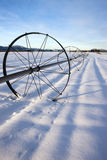 Irrigation wheel on snowy field. Stock Photography