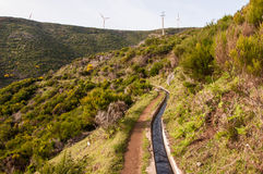 Irrigazione e energia eolica insieme Fotografia Stock