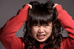 Irritable woman. A woman Zhuache with her hair, face very impatient Stock Photography
