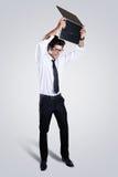 Irritado executivo com seu portátil Imagem de Stock
