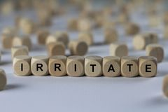 Irritate - cube with letters, sign with wooden cubes Royalty Free Stock Images