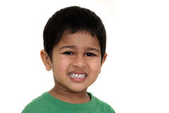 Irritated. An handsome Indian kid irritated at something stock photo