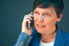 Irritated angry business woman during mobile phone conversation Royalty Free Stock Photo