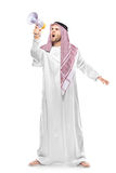An irritated arab person screaming on a megaphone Stock Photography
