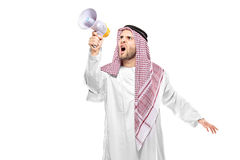 An irritated arab person screaming on a megaphone Royalty Free Stock Photography