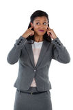 Irritated businesswoman covering her ears. Hear no evil concept Royalty Free Stock Photo