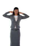 Irritated businesswoman covering her ears. Hear no evil concept Stock Photos