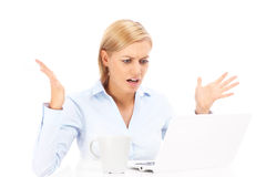 Irritated businesswoman with laptop Royalty Free Stock Image