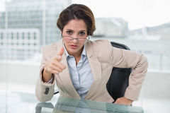 Irritated businesswoman looking at camera Royalty Free Stock Photo