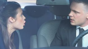 Irritated couple arguing loudly in car, stressful driving causes road accident. Stock footage stock footage