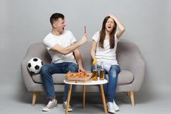 Irritated couple woman man football fans cheer up support favorite team swearing, holding megaphone, red card isolated. Irritated couple women men football fans stock photography