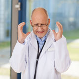 Irritated Doctor Gesturing In Clinic Stock Photo