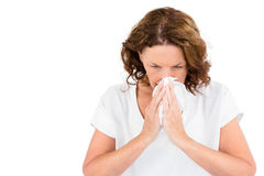 Irritated mature woman sneezing Royalty Free Stock Photos