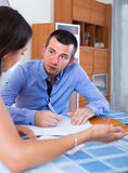 Irritated spouses having serious conversation Royalty Free Stock Photo