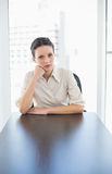 Irritated stylish brunette businesswoman posing looking at camera Royalty Free Stock Photos