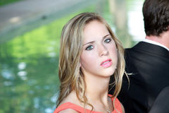 Irritated Teen Girl. Beautiful blonde teen girl irritated at her prom date royalty free stock image