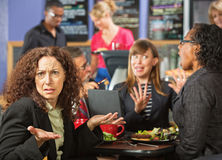 Irritated Woman in Cafe Stock Photography