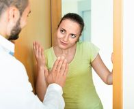 Irritated young couple  quarreling Stock Images