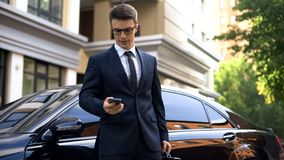 Irritated young male in formalwear chatting on phone, annoyed by problems. Stock photo royalty free stock photos