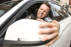 Irritated young man driving a car. Irritated driver Royalty Free Stock Photo