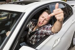 Irritated young man driving a car. Irritated driver Royalty Free Stock Images
