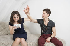 Irritated young man with woman playing video game Stock Photo