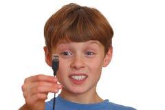 Irritation. Irritated boy looks at a USB jack Stock Photos