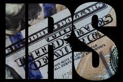 IRS, amerikanischer Geld-Makroabschluß oben von Ben Franklin-` s Gesicht auf dem Dollarschein US 100 Lizenzfreie Stockfotografie