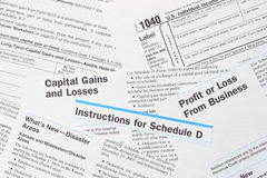IRS Federal Income Tax Forms. Including 1040 and Schedule D Capital Gains and Losses, along with instructions Stock Image