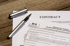 IRS form W-9 and a contract royalty free stock photo