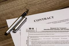 IRS form W-9 and a contract stock photography