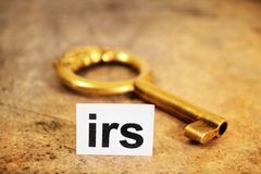 Irs and key concept. Close up of Irs and key concept Stock Image