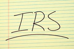 IRS On A Yellow Legal Pad Stock Photo
