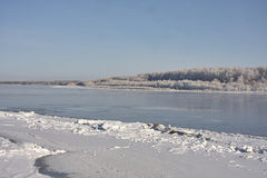 Irtish in deep autumn. Ice on banks, hoarfrost, clear sky, blue sky. clean white snow. Russia Stock Images