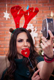 Irvas selfie!. Irvas girl filming herself on Xmas royalty free stock photography