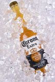 Corona Extra beer in ice. IRVINE, CALIFORNIA - MARCH 29, 2018: Closeup of a bottle of Corona Extra beer in ice. Corona is the most polular import in the USA stock image