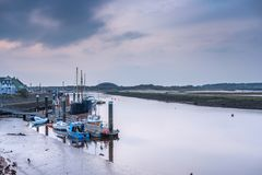 Irvine harbour at Low tide Scotland. Irvine harbour as the tide goes out on a cold Novembers day in Scotland. Image shows an old puffer and some other small stock images