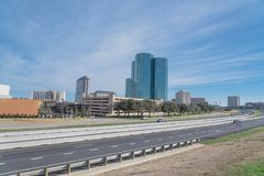 Irving, Texas skyline view from John Carpenter Freeway blue sky. Irving, Texas skyline view from John Carpenter Freeway under winter cloud blue sky. Cityscape royalty free stock images