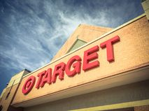 Entrance to Target the second-largest discount store retailer in. IRVING, TX, US-APR 17, 2018:Vintage close-up logo sign Target entrance cloud blue sky. Second stock images