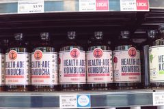 Healthy probiotic and fermented foods in Whole Foods store. IRVING, TX, USA-JUN 4, 2018: Various flavor Kombucha bottles at Whole Foods store. Cold fermented stock photography