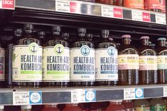 Healthy probiotic and fermented foods in Whole Foods store. IRVING, TX, USA-JUN 4, 2018: Various flavor Kombucha bottles at Whole Foods store. Cold fermented stock photo