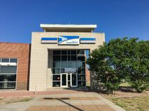 Facade entrance of USPS store in Irving, Texas, USA. IRVING, TX, USA-SEP 2, 2018:Entrance exttorior of USPS store sunny summer clear blue sky. The United States royalty free stock photography