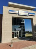 Facade entrance of USPS store in Irving, Texas, USA. IRVING, TX, USA-SEP 2, 2018:Entrance exttorior of USPS store sunny summer clear blue sky. The United States stock photography