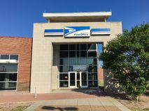 Facade entrance of USPS store in Irving, Texas, USA. IRVING, TX, USA-SEP 2, 2018:Entrance exttorior of USPS store sunny summer clear blue sky. The United States stock image