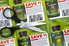 Irwin Naturals discount coupons with scissors. Tambov, Russian Federation - June 18, 2017 Irwin Naturals discount coupons with scissors Royalty Free Stock Image