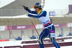 Iryna Bui (Ukraina) konkurrerar på vinterParalympic lekar i Sochi Arkivfoto